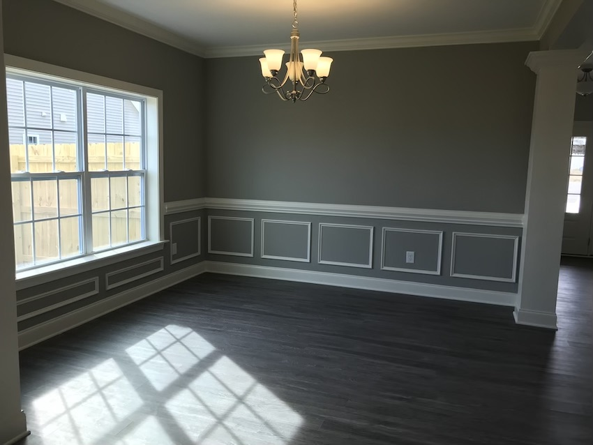 a dining room with wainscoting